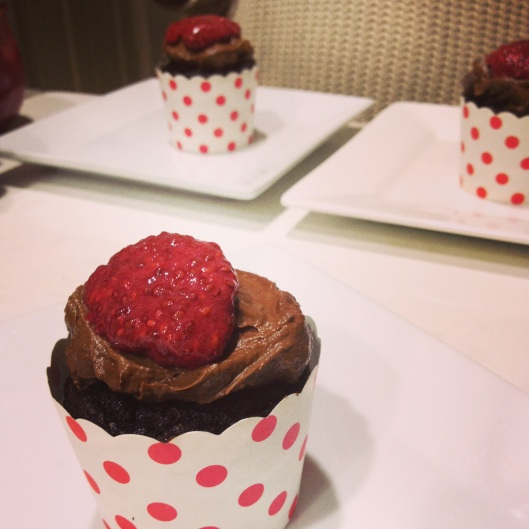 Emma's pure cacao cup cakes with raw cacao and avocado mousse and raspberry and chia seed jam.